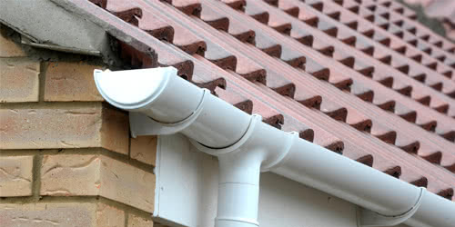 white UPVC guttering connected to a residence